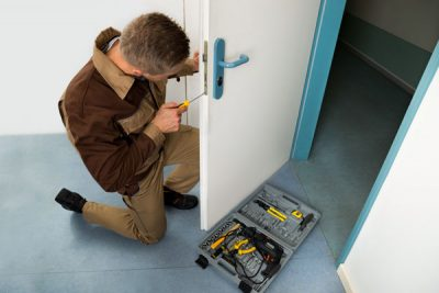 worker working on door lock